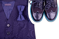 Boys dark blue vest with bow tie and modern shoes Royalty Free Stock Images