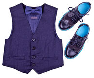 Boys dark blue vest with bow tie and modern shoes are isolated on white. Background stock photography