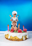 Boys decorate the cake Royalty Free Stock Photo