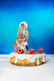 Boys decorate the cake Royalty Free Stock Images