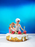 Boys decorate the cake Stock Images
