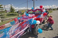 Boys decorating a car in red, white & blue in Lima Montana Stock Photos
