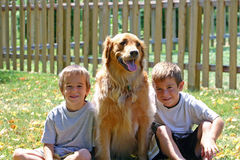 Boys and Dog Royalty Free Stock Images