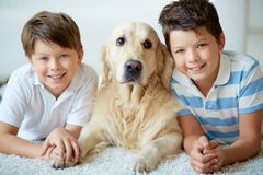 Boys with dog Stock Photography