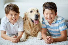 Boys with dog Royalty Free Stock Image