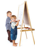 Boys are drawing on a blackboard Stock Photos