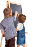 Boys are drawing on a blackboard Royalty Free Stock Photos