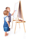 Boys are drawing on a blackboard Stock Image