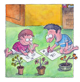 Boys are drawings on the floor. Two boys are drawings plants and flowers on paper royalty free illustration