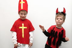 Boys dressed as Saint Nicholas and litte devil Stock Photography