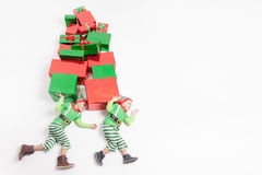 Boys dressed Elf costumes holding many gift boxes. Black Friday! Stock Photos