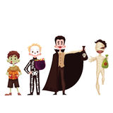 Boys dressed in skeleton, mummy, zombie, vampire costumes for Halloween Stock Images