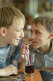Boys drinking coke Royalty Free Stock Image