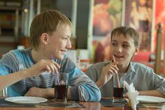 Boys drinking coke Stock Images