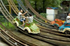 Boys driving Electric cars in Chengdu Park Royalty Free Stock Photography