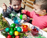Boys dyeing eggs easter fun. Two sweet little boys having fun dyeing eggs for easter Royalty Free Stock Photo