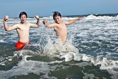 Boys enjoying the beautiful ocean and beach Stock Photo
