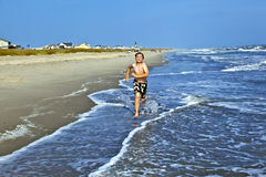 Boys enjoying the beautiful ocean and beach Stock Photography