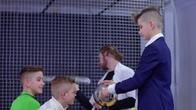 Boys explores reaction of electrostatic voltage on himself. Children and laboratory assistant make physical experiment with Van de Graaff generator in scinetific stock footage