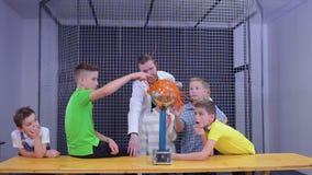 Boys explores van de graaff generator in scientific museum. Children and laboratory assistant make physical experiment with Van de Graaff generator in scinetific stock footage