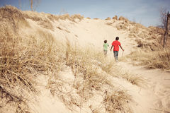 Boys exploring a sand dune Stock Images