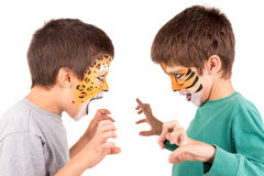Boys with face painted Stock Images