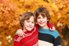 Boys in the Fall. Two Brothers Playing Outside in the Fall stock images