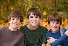 Boys in the Fall Leaves Royalty Free Stock Images
