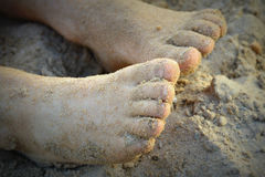Boys Feet in Sand at the Beach. This is a picture of two boys feet, ten toes, all covered with sand at the beach stock photos