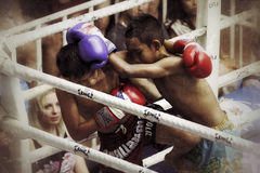 Boys fighting muay-thai. Muay Thai competition at Bangla Boxing Stadium in Patong, Phuket, Thailand Royalty Free Stock Image