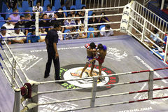 Boys fighting muay-thai. Boys fightinh at Bangla Boxing Stadium in Patong, Phuket, Thailand Royalty Free Stock Photo