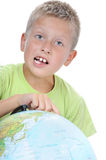Boys finger pointing on world globe Stock Photos
