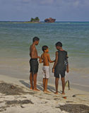 Boys with fish at San Andres beach, Colombia stock photography