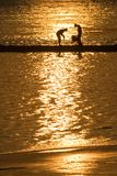 Boys fishing. Two boys fishing in the latest golden sunlight Royalty Free Stock Photography