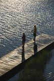 Boys fishing on dock. Royalty Free Stock Photos