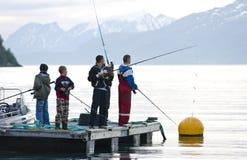 Boys fishing on fjord stock photo
