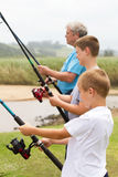 Boys fishing with grandpa royalty free stock photos