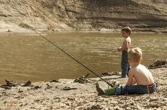 Boys fishing Royalty Free Stock Images