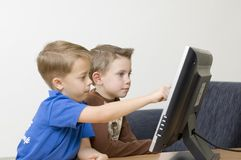 Boys / flat monitor / series. Boys watching cartoons. Focus on the face Royalty Free Stock Photography