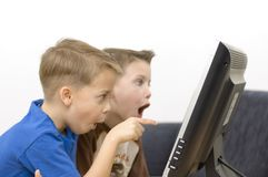 Boys / flat monitor / series. Boys watching cartoons. Focus on the finger Royalty Free Stock Photos
