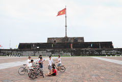 Boys in front of flag tower, Hue, Vietnam Royalty Free Stock Image