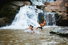 Boys Funny Waterfall Royalty Free Stock Photos