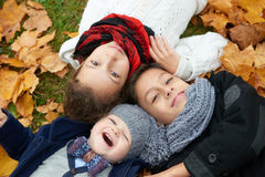Boys and girl in autumn park Stock Photography