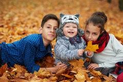 Boys and girl in autumn park Stock Image