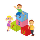 Boys, girl and cubes with letters Stock Photo