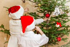 Boys and girl decorate christmas tree Stock Photography