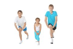 Boys and girl exercising Royalty Free Stock Images
