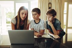 Kids using laptop computer for learning royalty free stock photos