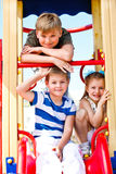 Boys and girl on the playground. Two school aged boys and girl on the playground Royalty Free Stock Photography