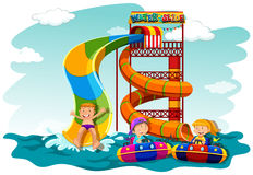 Boys and girl riding down the water slide Stock Photography